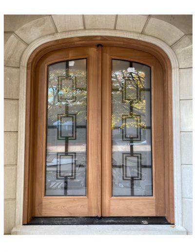 Transitional raw wood double door