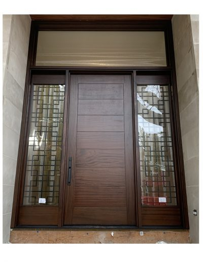 Modern Flat Dark Brown Wood Exterior Door with sidelits, decorative iron transom and horizontal grooves